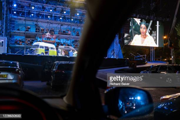Seen from the driver's seat British Soprano Nardus Williams plays Mimi in Puccini's La bohème performed by English National Opera as a drivein at...