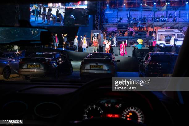 Seen from the driver's seat Puccini's La bohème is performed by members of English National Opera as a drivein at Alexandra Palace on 18th September...
