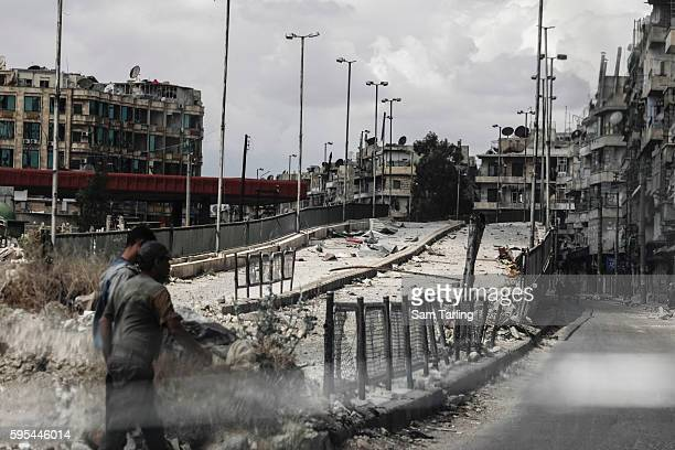 Seen from the window of a car an overpass lies empty blocked by barricades in the Sha'ar neighbourhood of Aleppo on June 3 2014