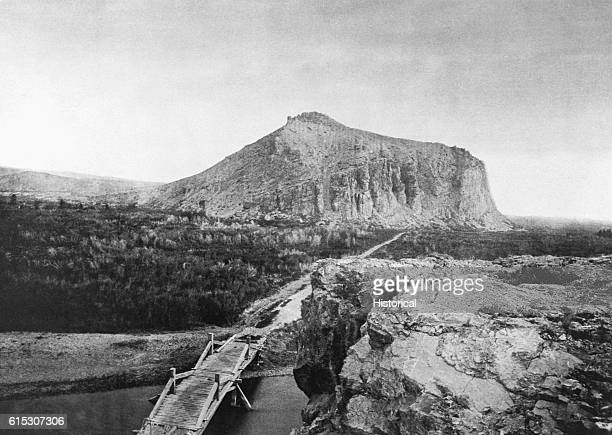 Seen here in 1871 the overland stage road between Ogden Utah and Helena Montana crosses the Beaverhead River at Point of Rocks by means of a plank...