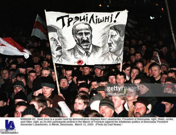 Seen here is a poster held by demonstrators displays Alex Lukashenko President of Belorussia right Stalin center and Hitler right as 25000...