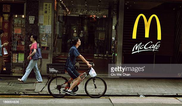 Seen here is the modern fast food chain and parked in front is a traditional delivery man on his bicycle sending food ordered from local Hong Kong...