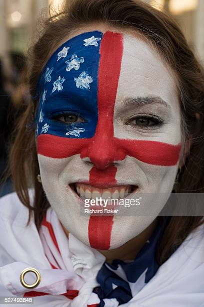 Seen in a closeup detail we see a young woman's face painted with an amalgamation of both the US and English flags during both countries opening...