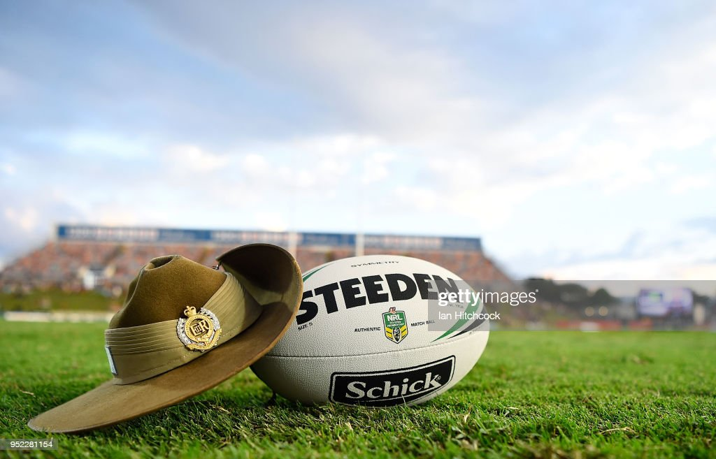 Seen is a match ball and an Australian Army Slouch Hat on the field of play before the start of the round eight NRL match between the North Queensland Cowboys and the Canberra Raiders at 1300SMILES Stadium on April 28, 2018 in Townsville, Australia.