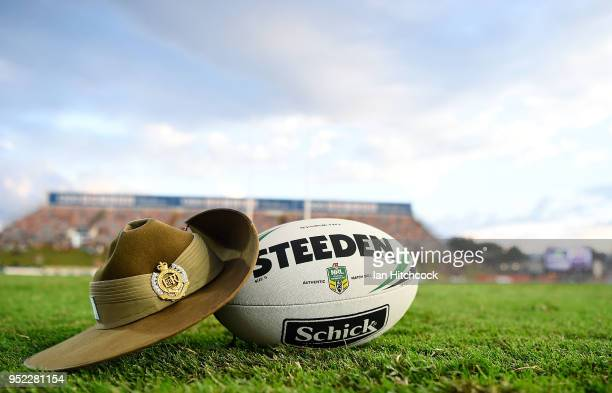 Seen is a match ball and an Australian Army Slouch Hat on the field of play before the start of the round eight NRL match between the North...