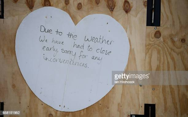 Seen is a shop closure notice at an ice cream shop on the Strand in preparation for Cyclone Debbie on March 27 2017 in Townsville Australia Cyclone...