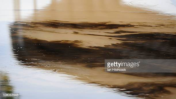 Seen is an oil slick floating on the water as flood waters fall on January 16 2011 in Rockhampton Australia Rockampton experienced some of...