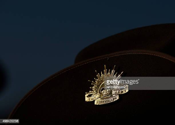 Seen is the iconic 'Rising Sun' hat badge worn by an Australian soldier from the Royal Australian Regiment during a commemorative parade at Lavarack...