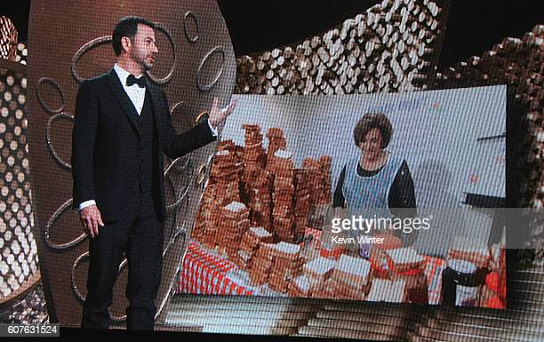Seen on video screen host Jimmy Kimmel speaks to mother Joann Iacono as she makes peanut butter and jelly sandwiches for the audience during the 68th...