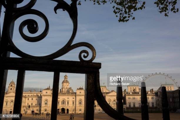 Seen through iron railings is Horseguards in Westminster on 9th November 2017 London England Horse Guards is a large Grade I listed historical...