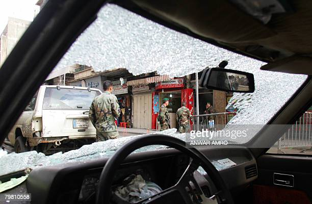 Seen through the shattered windscreen of a vehicle Lebanese soldiers patrol the streets of the capital Beirut on February 17 2008 Twenty people were...