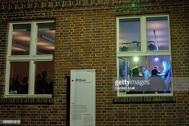 Seen through the windows the former East German rock band Speiches Monokel performs at the Hohenschoenhausen memorial and former prison of the East...