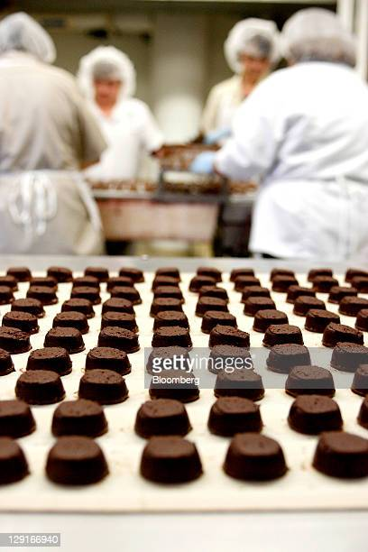 See's Candies Inc. Chocolate truffle travel down a conveyor belt before being coated in the truffle room at the company's factory in San Francisco,...