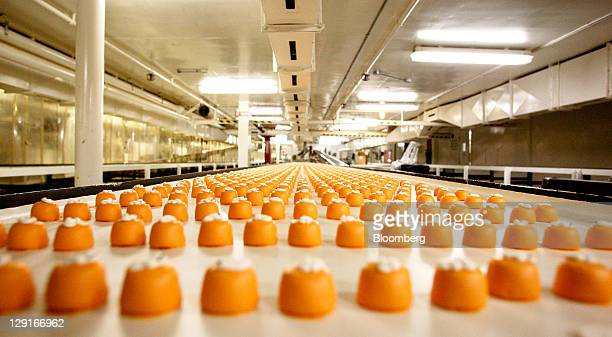 See's Candies Inc. Pumpkin candies travel down a conveyor belt before being boxed at the company's factory in San Francisco, California, U.S., on...