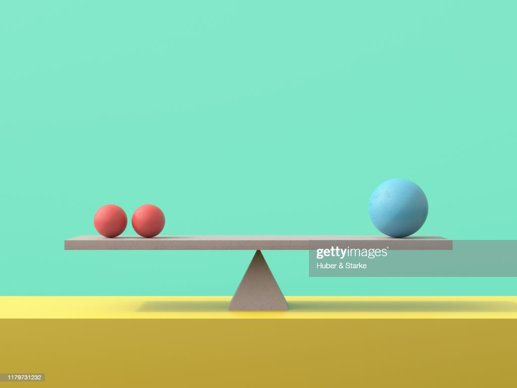 seesaw with concrete spheres : Stock Photo