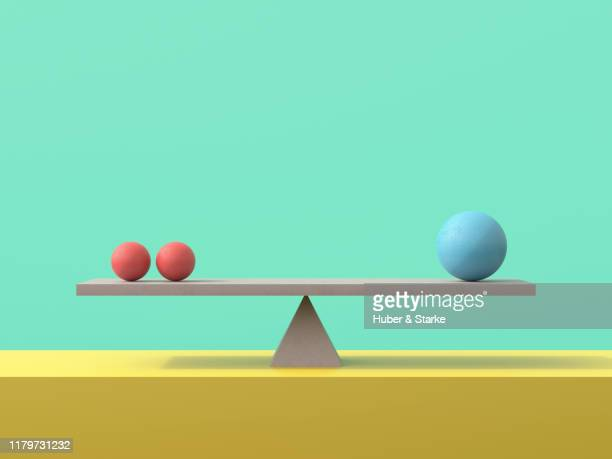 seesaw with concrete spheres - scales stock pictures, royalty-free photos & images