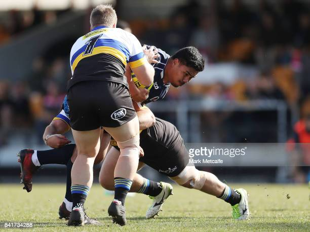 Sef Fa'agase of Queensland Country is tackled during the round one NRC match between Canberra and Queensland Country at Viking Park on September 2...