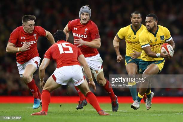 Sefa Naivalu of Australia runs at Leigh Halfpenny of Wales as Jonathan Davies and Josh Adams close in during the International Friendly match between...