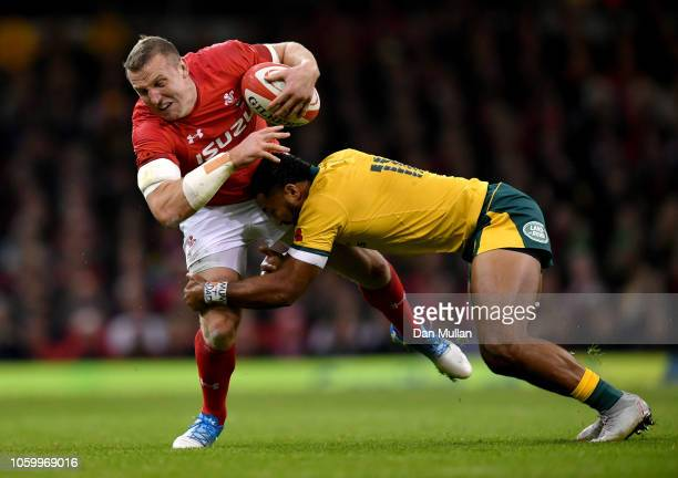 Sefa Naivalu of Australia tackles Hadleigh Parkes of Wales during the International Friendly match between Wales and Australia at Principality...