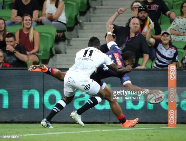 Sefa Naivalu of the Rebels scores a try during the Super Rugby union match between the Melbourne Rebels of Australia and the Coastal Sharks of South...