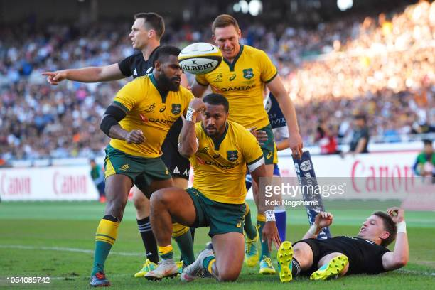 Sefa Naivalu of the Wallabies celebrates scoring a try with his team mates during the Bledisloe Cup test match between New Zealand All Blacks and...