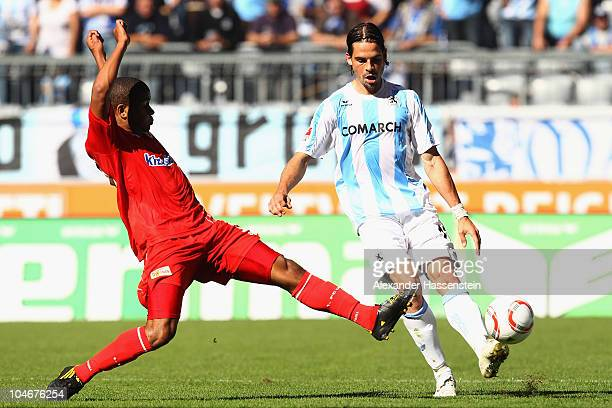 Sefan Buck of Muenchen battles for the ball with Chinedu Ede of Berlin during the Second Bundesliga match between TSV 1860 Muenchen and Union Berlin...