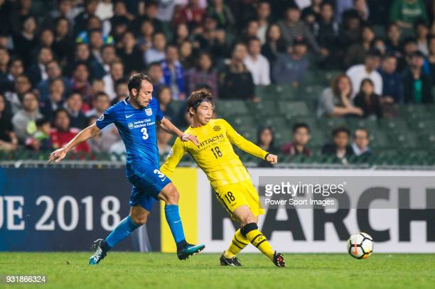 Segawa Yusuke of Kashiwa Reysol battles for the ball with Daniel Cancela Rodriguez of Kitchee SC during the AFC Champions League Group E match...