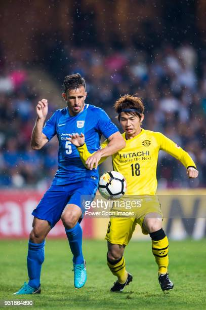 Segawa Yusuke of Kashiwa Reysol fights for the ball with Helio Jose De Souza Goncalves of Kitchee SC during the AFC Champions League Group E match...