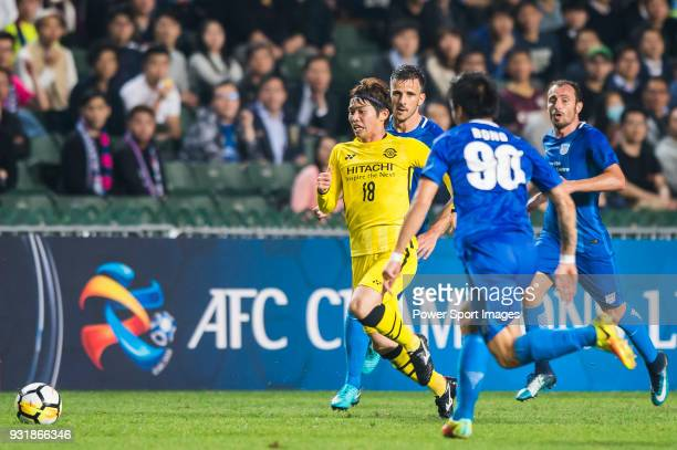 Segawa Yusuke of Kashiwa Reysol is tackled by Kitchee SC's players during the AFC Champions League Group E match between Kitchee and Kashiwa Reysol...