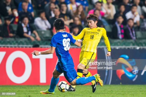 Segawa Yusuke of Kashiwa Reysol vies for the ball with Kim Bongjin of Kitchee SC during the AFC Champions League Group E match between Kitchee and...
