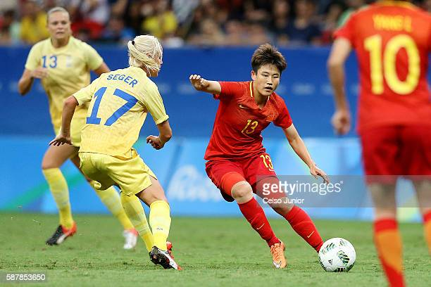 Seger Caroline Sweden and Pang Fengyue China at China PR v Swede Women's Football Olympics Day 4 at Mane Garrincha Stadium on August 9 2016 in...