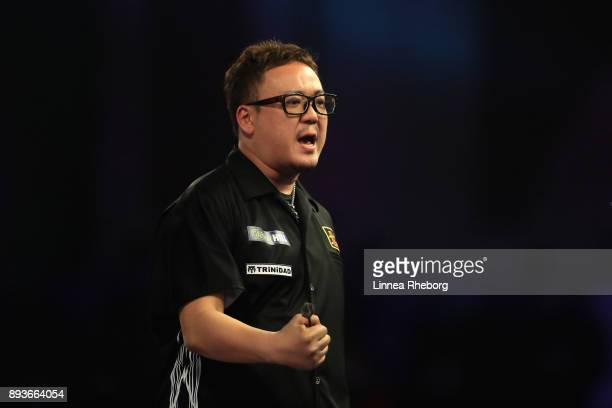 Segio Asada of Japan celebrates after winning his match against Gordon Mathers during day two of the 2018 William Hill PDC World Darts Championships...