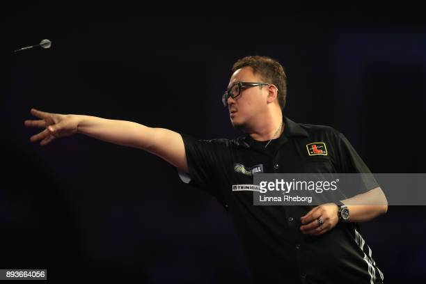 Segio Asada of Japan in action during his first match against Gordon Mathers during day two of the 2018 William Hill PDC World Darts Championships at...