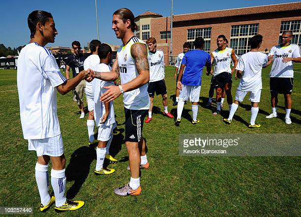Segio Ramos of Real Madrid greets local youth soccer players participating in the Adidas training August 5 2010 in Westwood section of Los Angeles...
