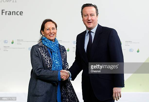 Segolene Royal, French Minister of Ecology, Sustainable Development and Energy welcomes British Prime Minister David Cameron as he arrives for the...