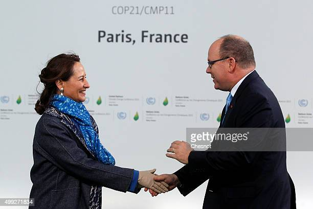 Segolene Royal, French Minister of Ecology, Sustainable Development and Energy welcomes Prince Albert II of Monaco as he arrives for the COP21 United...