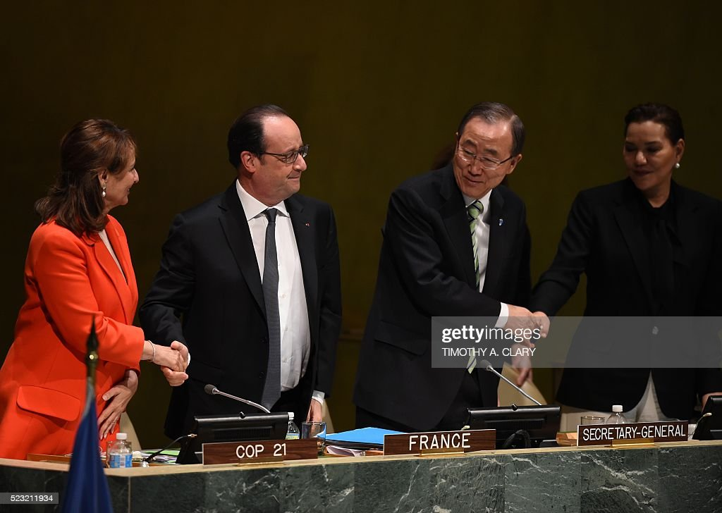 Segolene Royal, French Minister of Ecology, Sustainable Development and Energy, French President Francois Hollande, UN Secretary General Ban Ki-moon,and Princess Lalla Salma of Morocco, attend the high level signature ceremony for the Paris Agreement at the United Nations General Assembly Hall April 22, 2016 in New York. / AFP / TIMOTHY