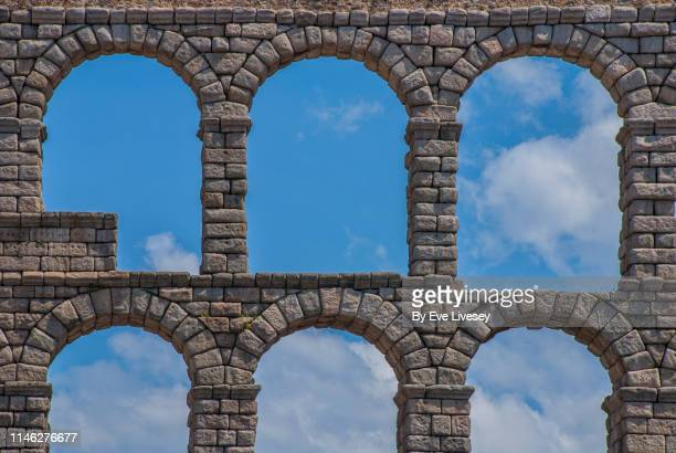 segovia aqueduct - segovia stock pictures, royalty-free photos & images