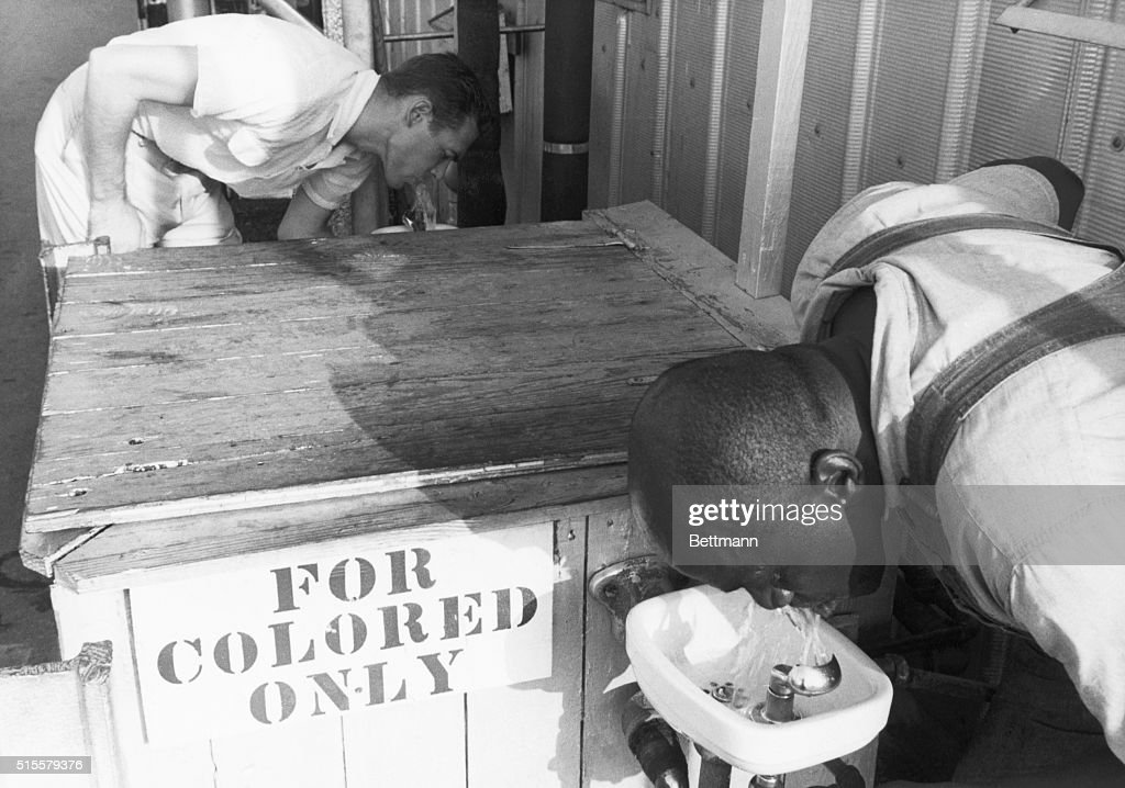 Men Drinking from Segregated Water Fountains : News Photo