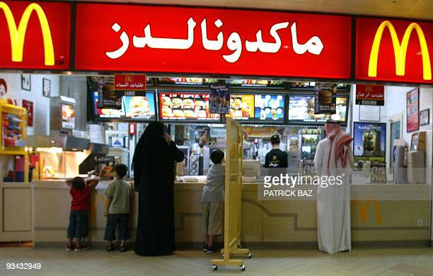 A segregation board separates men and women at a US fastfood chain in Riyadh 11 July 2004 Restaurants in Saudi are divided into the family section...