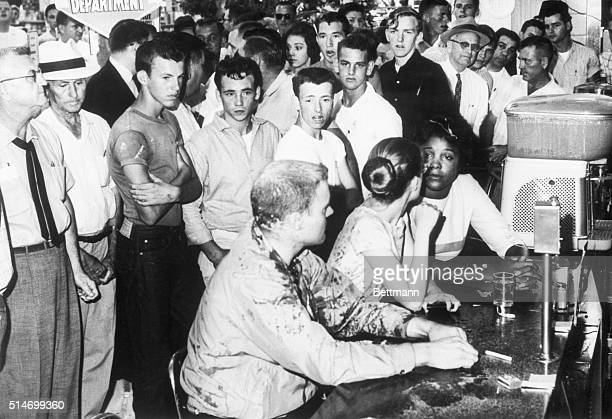 Segregation protesters Professor John R. Salter, Joan Trunpauer, and Annie Moody remain at a sit-in at a lunch counter in Jackson, Mississippi even...