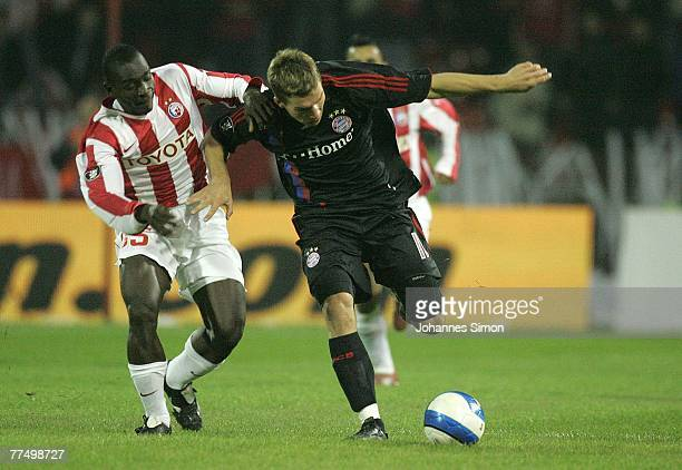 Segundo Castillo of Belgrade and Lukas Podolski of Bayern are seen in action during the UEFA Cup group F match between Crvena Zvezda and Bayern...