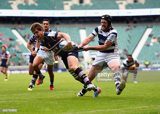 Segundo Taculet of Buenos Aires is held back by Jeremy Innes of Auckland during the Cup Final match between Buenos Aires and Auckland during the...