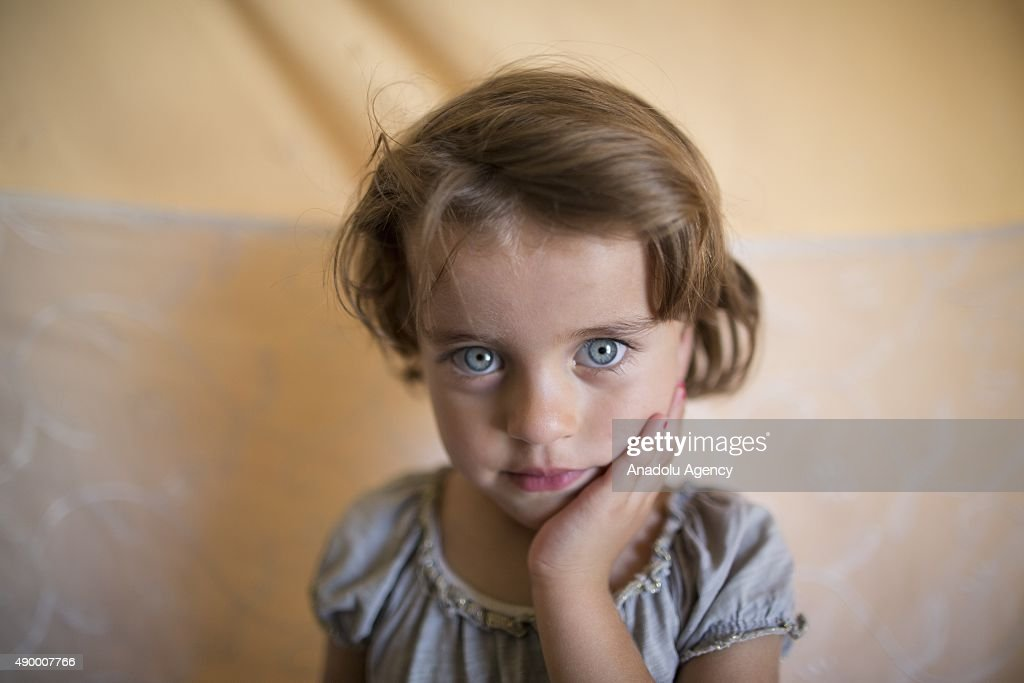 Sehat Fetih, a Syrian refugee girl who fled Homs with her family, is seen in her family's tent at a tent city in the Akcakale District of Sanliurfa, Turkey on September 24, 2015. 260 thousand Syrians who have escaped war and found asylum in Turkey are now living in camps with opportunities that mean they don't miss what they've left behind.