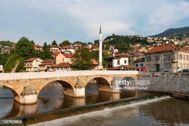 seher-cehajina ottoman bridge on the miljacka river in sarajevo, bosnia and herzegovina - sarajevo stock pictures, royalty-free photos & images