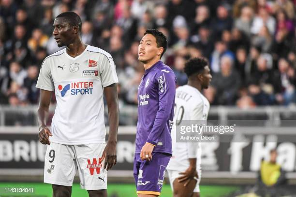 Sehrou Guirassy of Amiens and Gen Shoji of Toulouse during the Ligue 1 match between Amiens and Toulouse on May 11 2019 in Amiens France