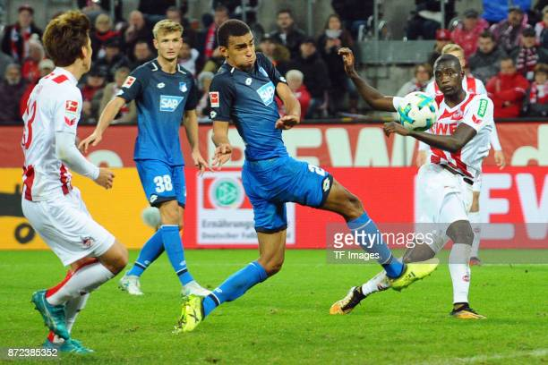 Sehrou Guirassy of FC Koeln and Kevin Akpoguma of Hoffenheim battle for the ball during the Bundesliga match between 1 FC Koeln and TSG 1899...