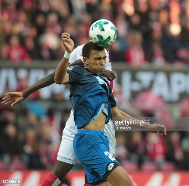 Sehrou Guirassy of FC Koeln and Kevin Akpoguma of Hoffenheim battle for the ball during the Bundesliga match between 1 FC Koeln und TSG 1899...