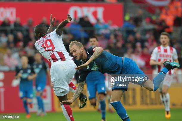 Sehrou Guirassy of FC Koeln and Kevin Vogt of Hoffenheim battle for the ball during the Bundesliga match between 1 FC Koeln und TSG 1899 Hoffenheim...