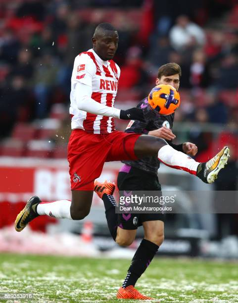 Sehrou Guirassy of FC Koeln controls the ball ahead of Pascal Stenzel of SC Freiburg during the Bundesliga match between 1 FC Koeln and SportClub...